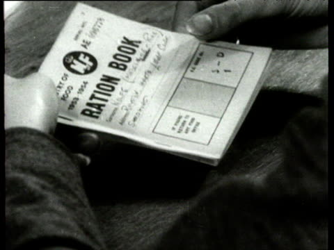 hand tearing world war ii ration book in half at the end of rationing 1950's - tearing stock videos & royalty-free footage