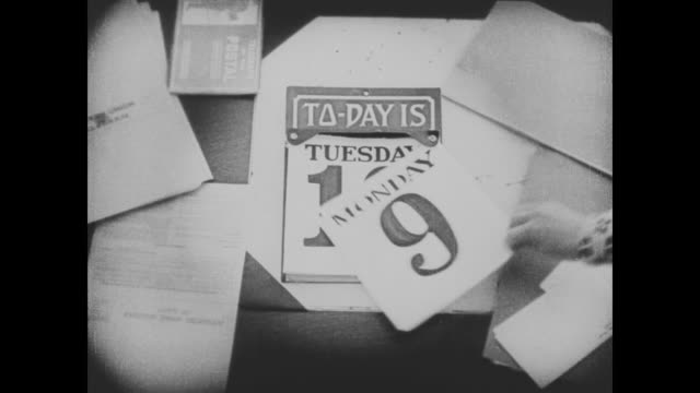 "1920 a hand tears off the date from a calendar revealing the new date of ""tuesday 10"" - week video stock e b–roll"