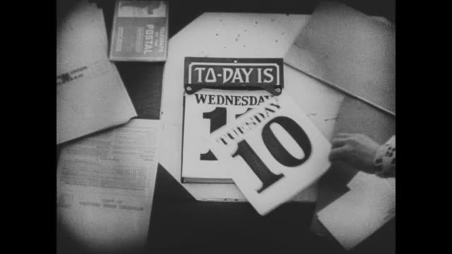"1920 a hand tears off the date from a calendar revealing the new date of ""wednesday 11"" - telegram stock videos and b-roll footage"