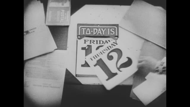 "1920 a hand tears the date from the calendar and exposes ""friday 13"" - telegram stock videos and b-roll footage"