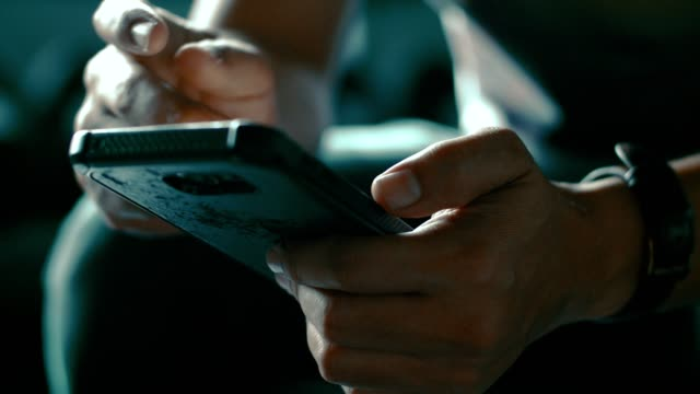 cu : hand texting messages on smart phone - scrolling video stock e b–roll