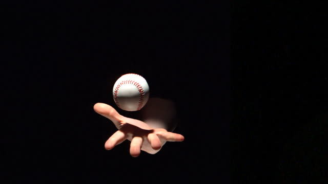 vídeos de stock, filmes e b-roll de hand throwing a baseball ball - interior