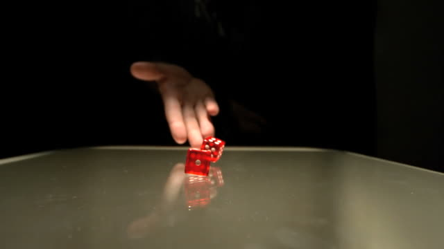 hand throwing two red dice - dice stock videos & royalty-free footage