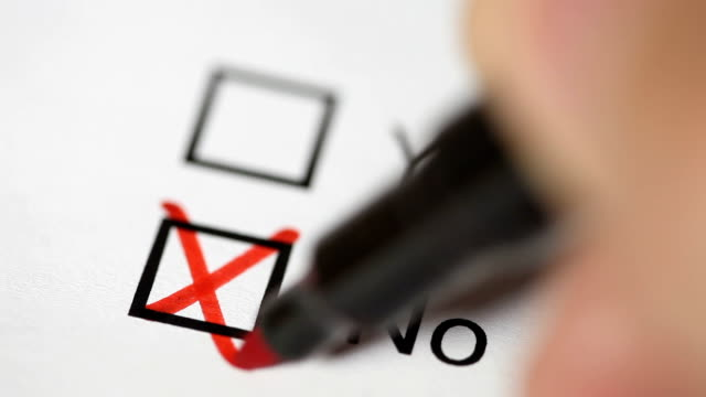 hand tick off in checklist. yes or no. 2 shots - voting ballot stock videos and b-roll footage