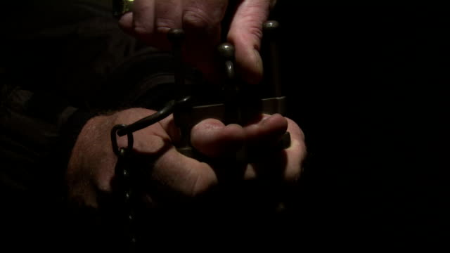a hand tightens the thumbscrews on a torturing device. - torture stock videos & royalty-free footage