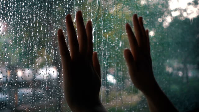 hand touching window on a rain day - regret stock videos & royalty-free footage