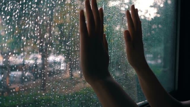 hand touching window on a rain day - mourning stock videos & royalty-free footage
