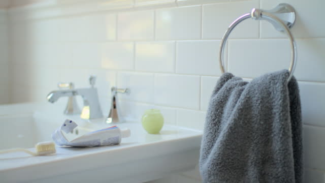 hand towel and bathroom sink - domestic bathroom stock-videos und b-roll-filmmaterial
