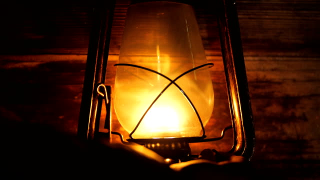 hand turn on lantern lamp at night - electric lamp video stock e b–roll