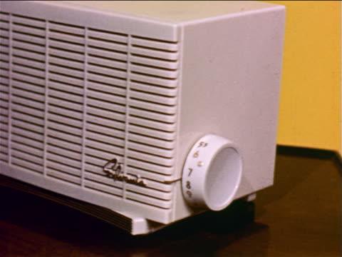 vídeos y material grabado en eventos de stock de 1957 hand turning knob on small appliance on table / industrial - 1957