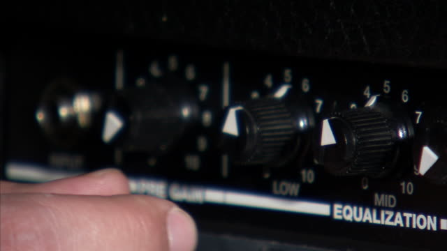 cu hand turning knobs on guitar amplifier - amplifier stock videos & royalty-free footage