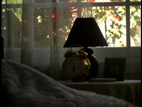 hand turning off alarm clock - alarm clock stock videos & royalty-free footage