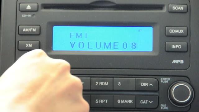 CU Hand turning off car radio, Los Angeles, California, USA