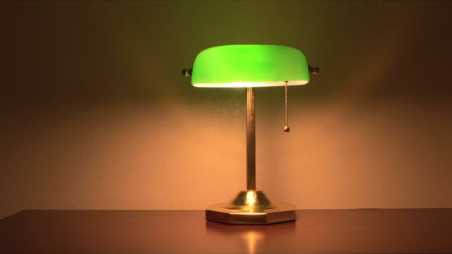 WS Hand turning off desk lamp, Memphis, Tennessee, USA
