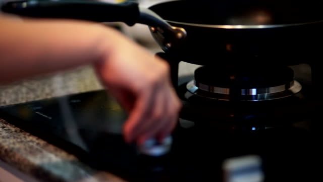 hand turns knob gas flame - cooker stock videos and b-roll footage