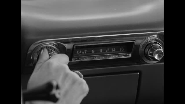 1962 hand (pov) turns on a car radio - dial stock videos & royalty-free footage