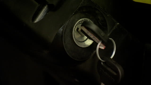 a hand turns the keys in a car's ignition. - key stock videos & royalty-free footage
