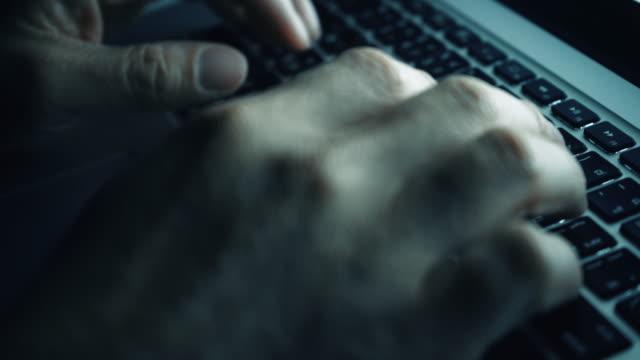 hand typing on laptop keyboard,close-up - l'uomo e la macchina video stock e b–roll