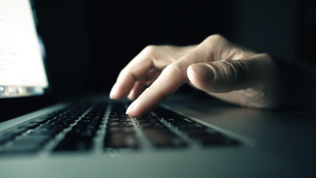 hand typing on laptop keyboard,close-up - shift key stock videos & royalty-free footage