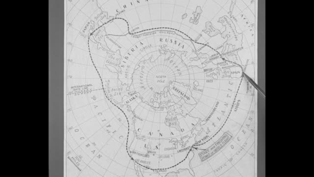 hand uses pencil to trace route on map as vo man describes the graf zeppelin's planned itinerary for its flight around the world / note: exact day... - personal organiser stock videos & royalty-free footage