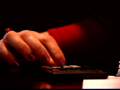 hand using calculator - one mature woman only stock videos & royalty-free footage
