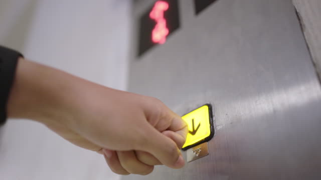 hand using finger knuckle to press down button of elevator because covid-19 or corona virus is invisible - human finger stock videos & royalty-free footage