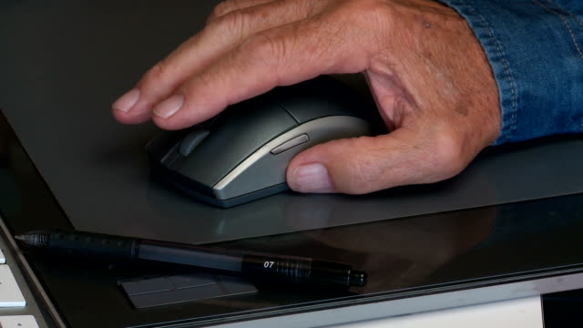 hand using graphics tablet mouse