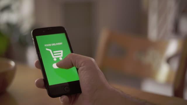 vídeos de stock e filmes b-roll de hand using mobile phone shopping online food delivery - objeto manufaturado