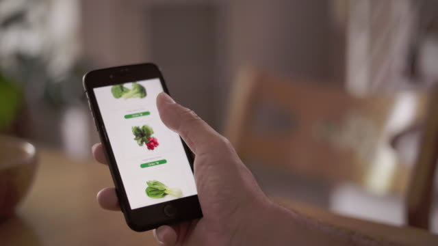 hand using mobile phone shopping online food delivery - ordine video stock e b–roll