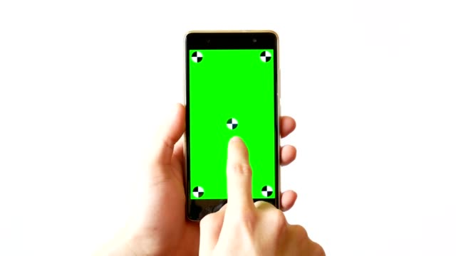 hand using mobile phone with green screen using multiple touch screen gesture on white background