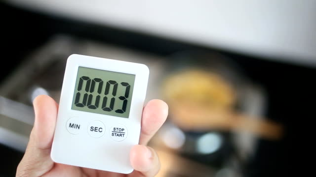 hand using stop watch in kitchen. - timer stock videos & royalty-free footage