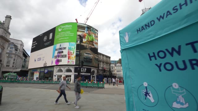 a hand washing centre in piccadilly circus on june 28th more retailers are reopening with social distancing measures after being shuttered for months... - cleaning stock videos & royalty-free footage
