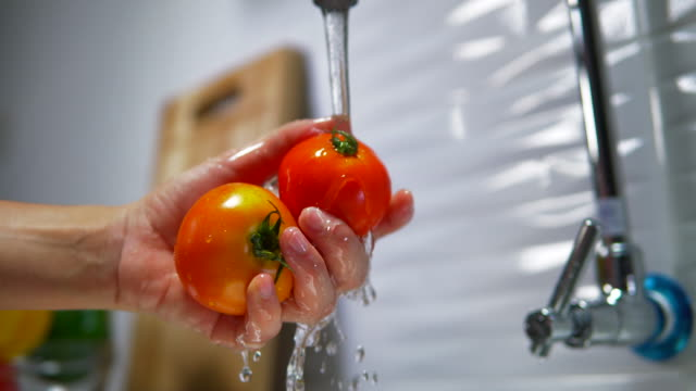 hand washing vegetables - tomato stock videos & royalty-free footage