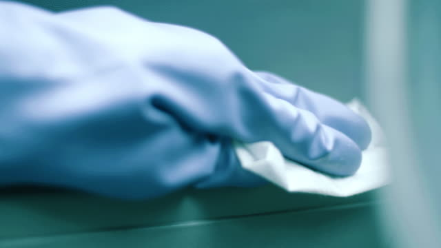 hand wiping down a car interior - protective glove stock videos & royalty-free footage