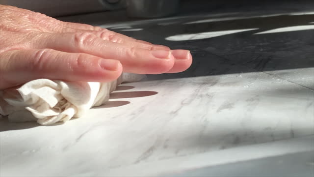 hand wiping down kitchen counter 2 - kitchen worktop stock videos & royalty-free footage