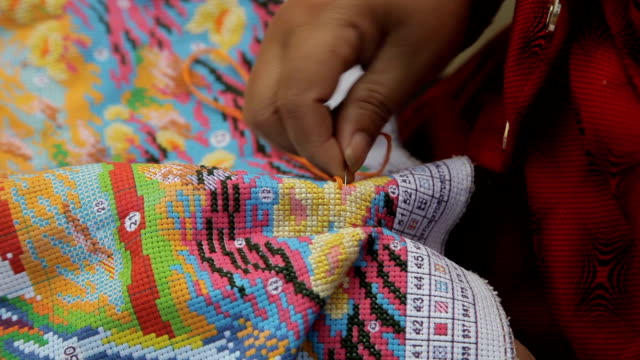 hand with cross stitch in china - sewing stock videos & royalty-free footage