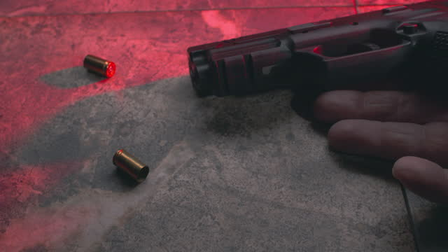 hand with handgun on floor - number 6 stock videos & royalty-free footage