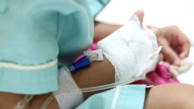 hand with saline intravenous - examination gown stock videos & royalty-free footage