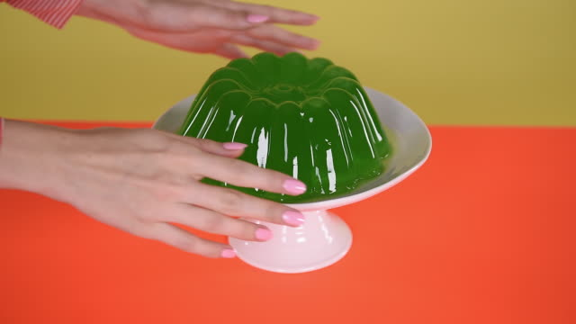 hand wobbling green jelly - hungry stock videos and b-roll footage