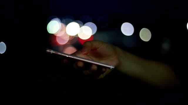 hand women using smartphone, night. - computer equipment stock videos & royalty-free footage