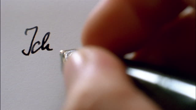 a hand writes the words, ich liebe dich. - liebe stock videos & royalty-free footage