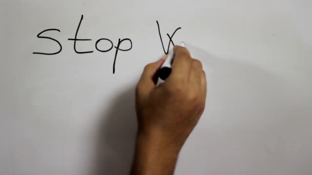 """hand writing a """"stop wishing start doing"""" message on a white board using a black marker - whiteboard stock videos and b-roll footage"""
