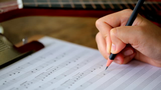 Hand writing musical notes (Dolly shot)