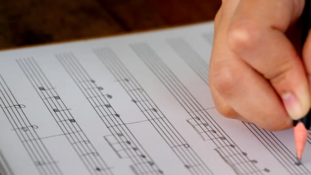 Hand writing musical notes (Dolly shot)