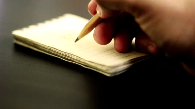hand writing on notebook - writing stock videos & royalty-free footage