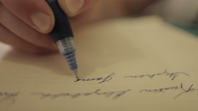 Hand writing on paper with blue ink