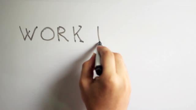 Hand writing title 'WORK HARD DREAM BIG' on white board