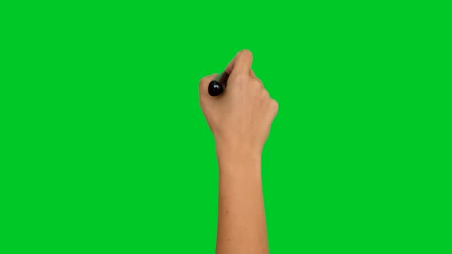 4k hand writing with a pen on greenscreen - green background stock videos & royalty-free footage