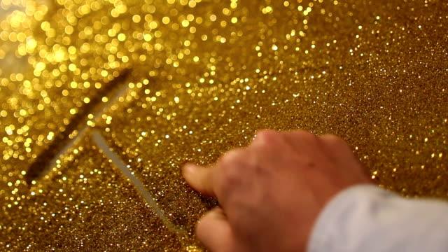 "hand writing""trust"" on golden sand background"