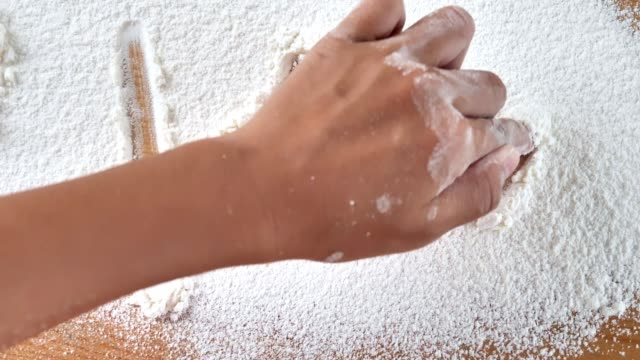 hand writting love message on flour powder on table, cooking concept. - capital letter stock videos & royalty-free footage